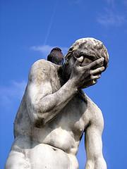 Depressed thinker statue