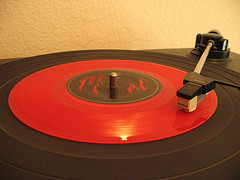 Red vinyl record on a turntable