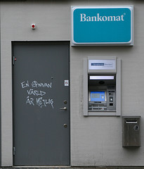 "ATM and graffiti - ""another world is possible"""