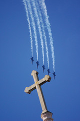 cross and jet planes