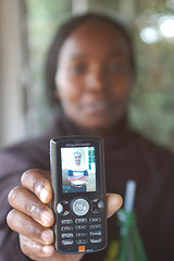 Kenyan woman with mobile phone