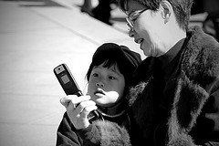 mother, child and cellphone