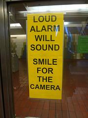 surreal surveillance warning signs