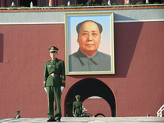 Soldier guarding portrait of Mao Zedong in Tiananmen Square