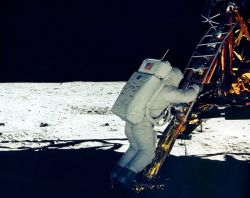 Buzz Aldrin begins his moonwalk