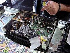 Xbox undergoing a (probably illegal) modification procedure