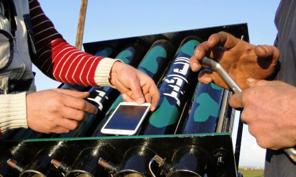 Syrian rebel fighters using iPhone as compass